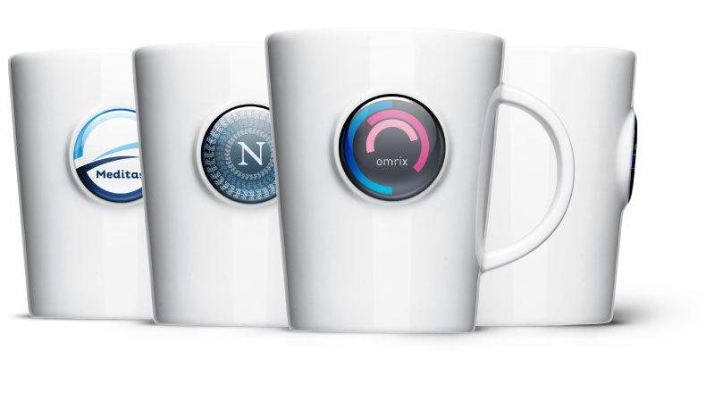 Werbetasse schnell beruckt: Logo Doming auf Porzellan